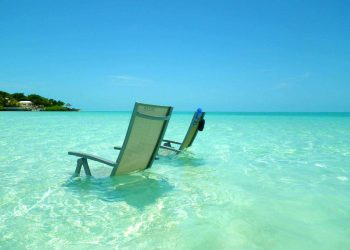 two chairs in the water island vacation private jet charter